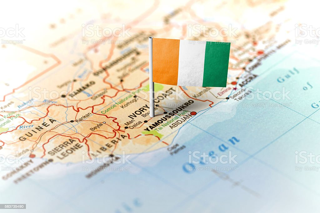 Ivory Coast pinned on the map with flag stock photo