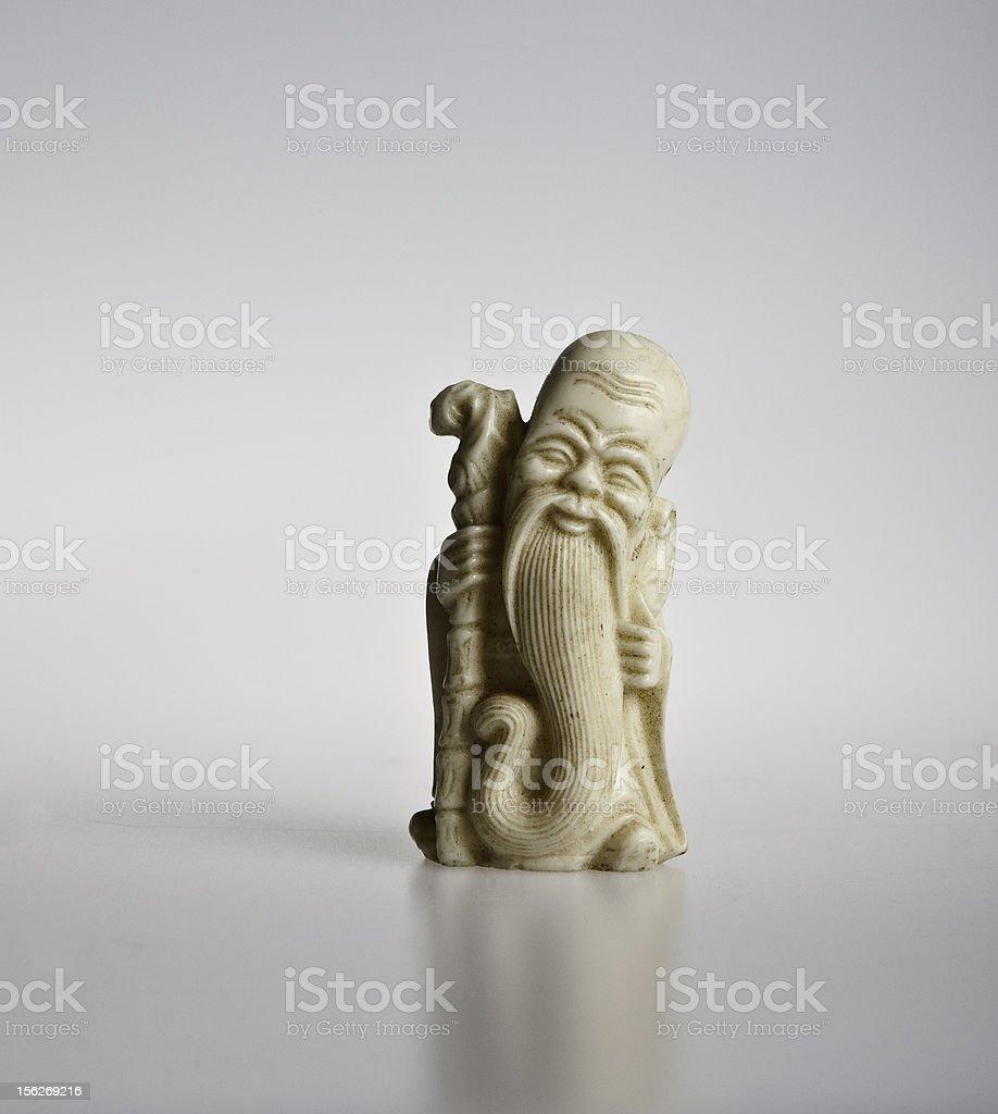 ivory figurine on white background stock photo