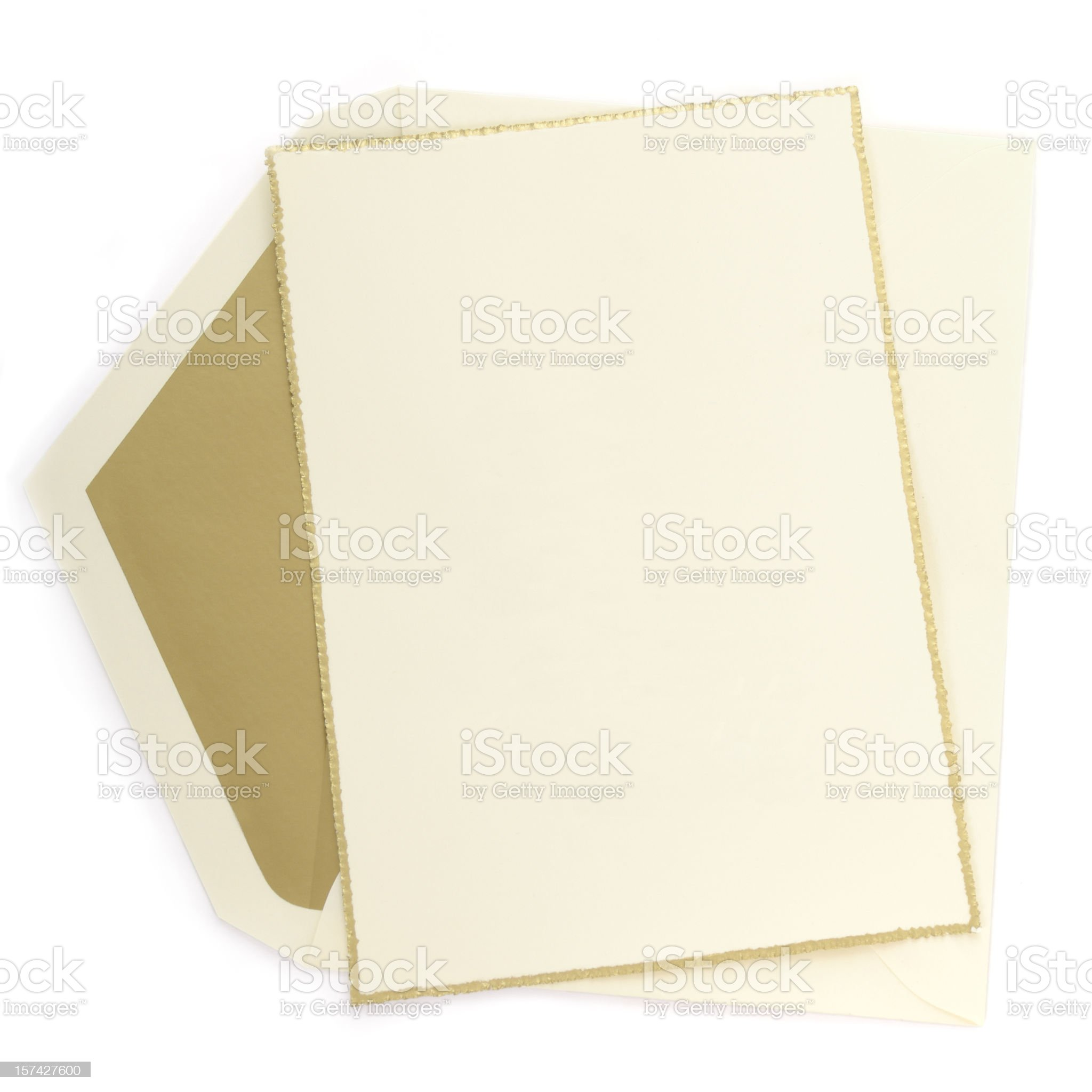 Ivory paper blank card with gold border, matching lined envelope royalty-free stock photo