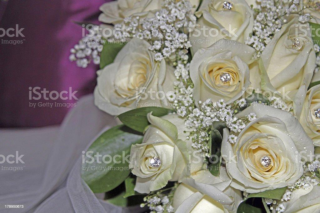 ivory wedding rose bouquet on purple background stock photo
