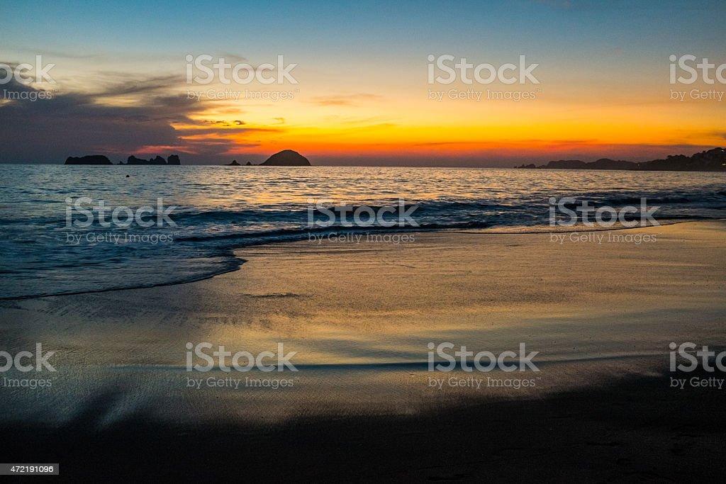 Ixtapa bay beach view at sunset stock photo