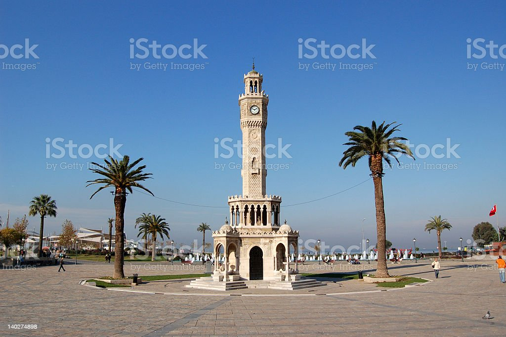 Izmir clock tower with palm trees stock photo
