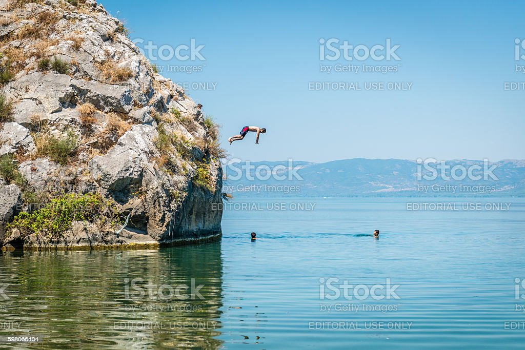 Iznik lake in Turkey. People jumping from cliff stock photo