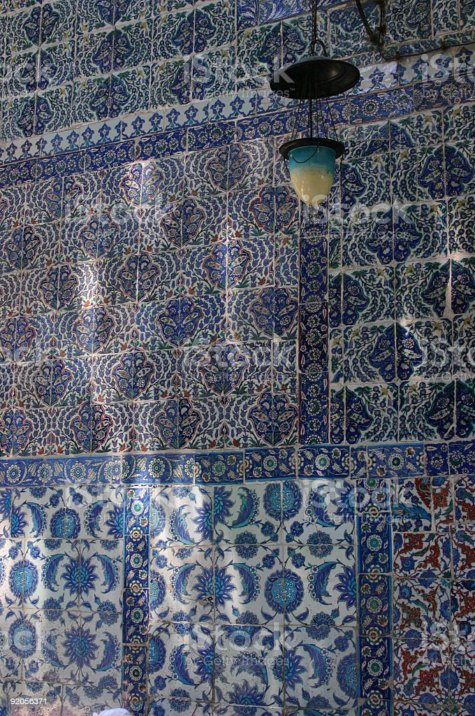Iznik tiles, intricate patterns, with dappled shadows stock photo