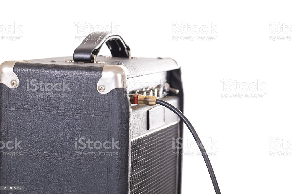 jack connector into the amplifier guitar on white background stock photo