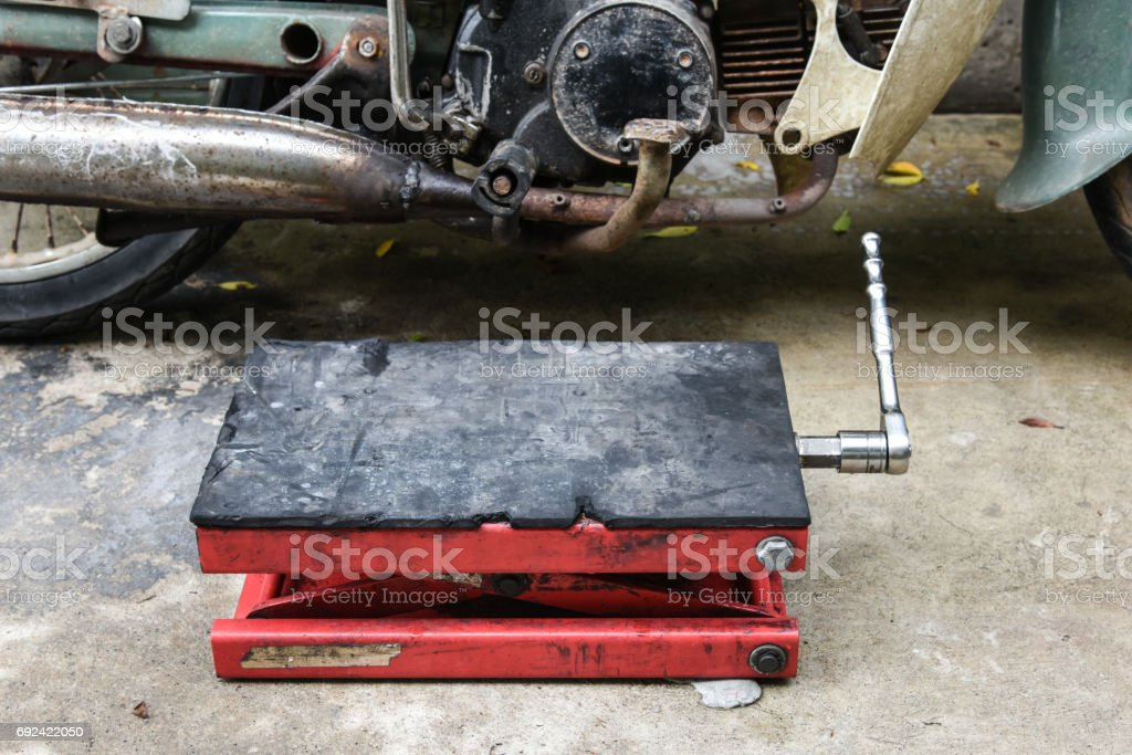 jack lift ready to old motorcycle repair service, jack lift for car service stock photo