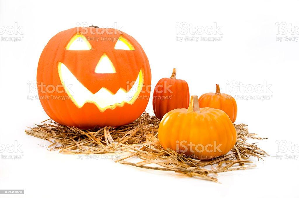 Jack O' Lantern and pumpkins on white background royalty-free stock photo