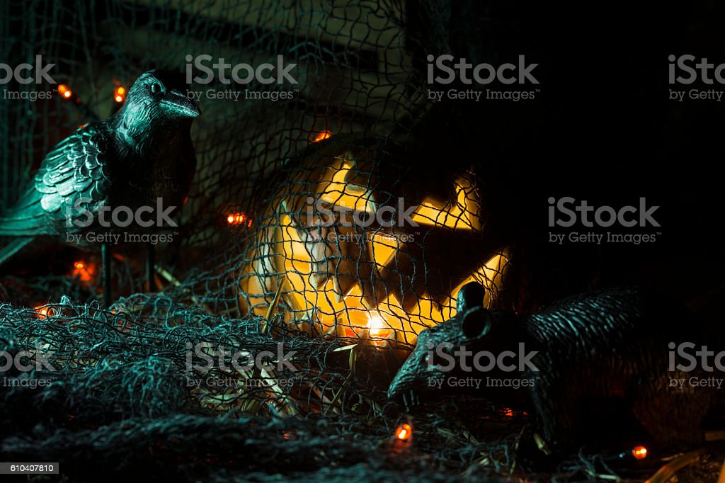 Jack O' Lantern Captured by Evil Rat and Crow stock photo