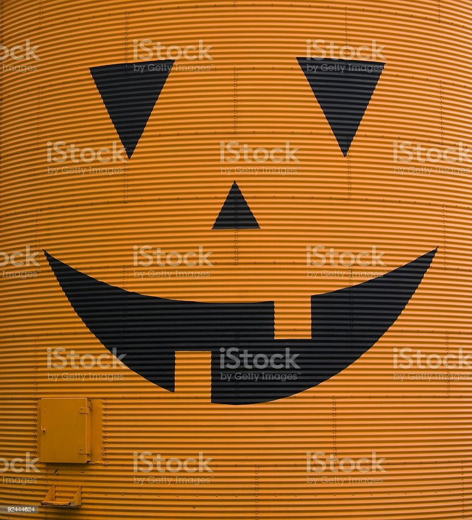 jack o lantern face on grain bin stock photo