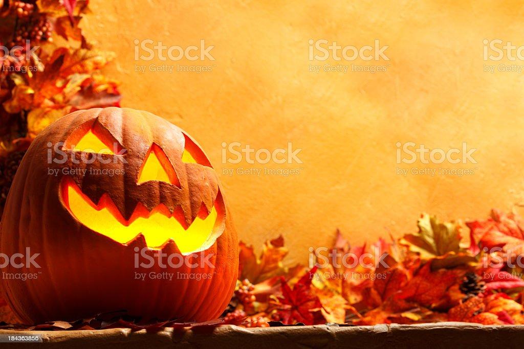 Jack O' Lantern in an autumn setting stock photo