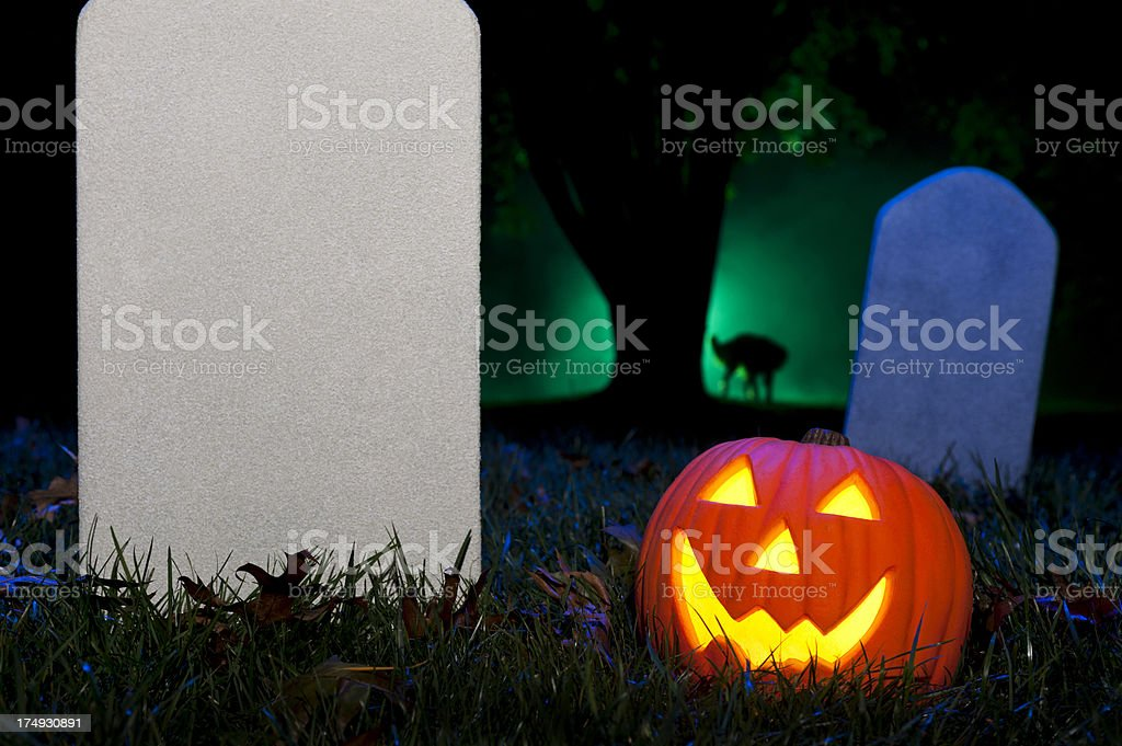 Jack O' Lantern in foggy Halloween Cemetery stock photo