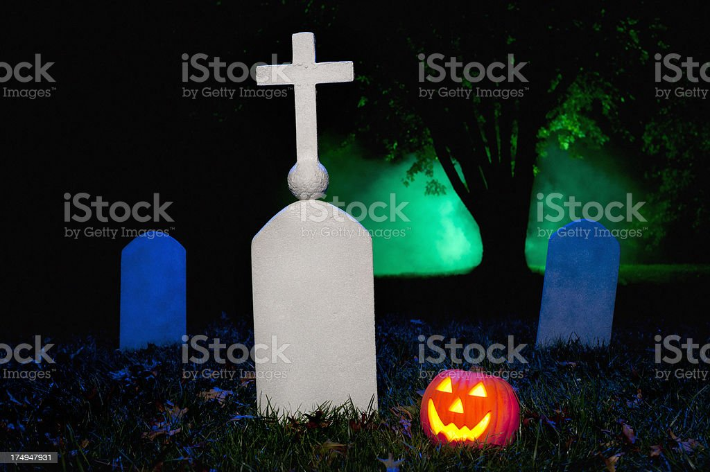 Jack O' Lantern in foggy Halloween Cemetery royalty-free stock photo