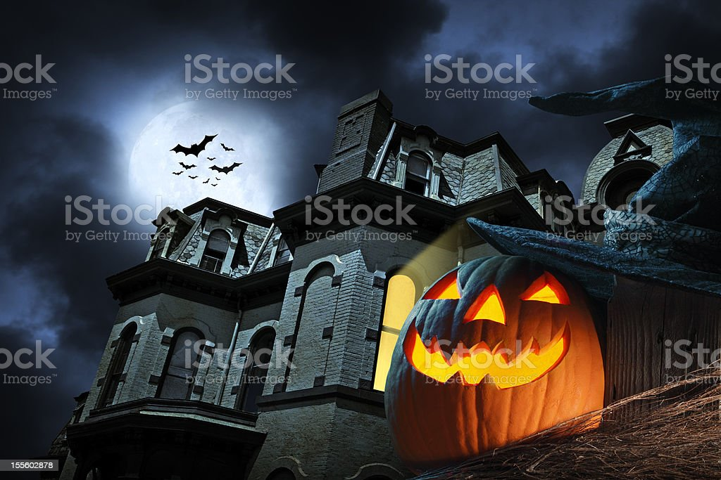 Jack O' Lantern in front of haunted hose stock photo