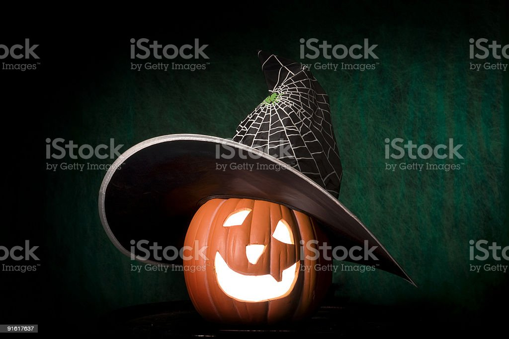 Jack O' Lantern in the witch hat. royalty-free stock photo