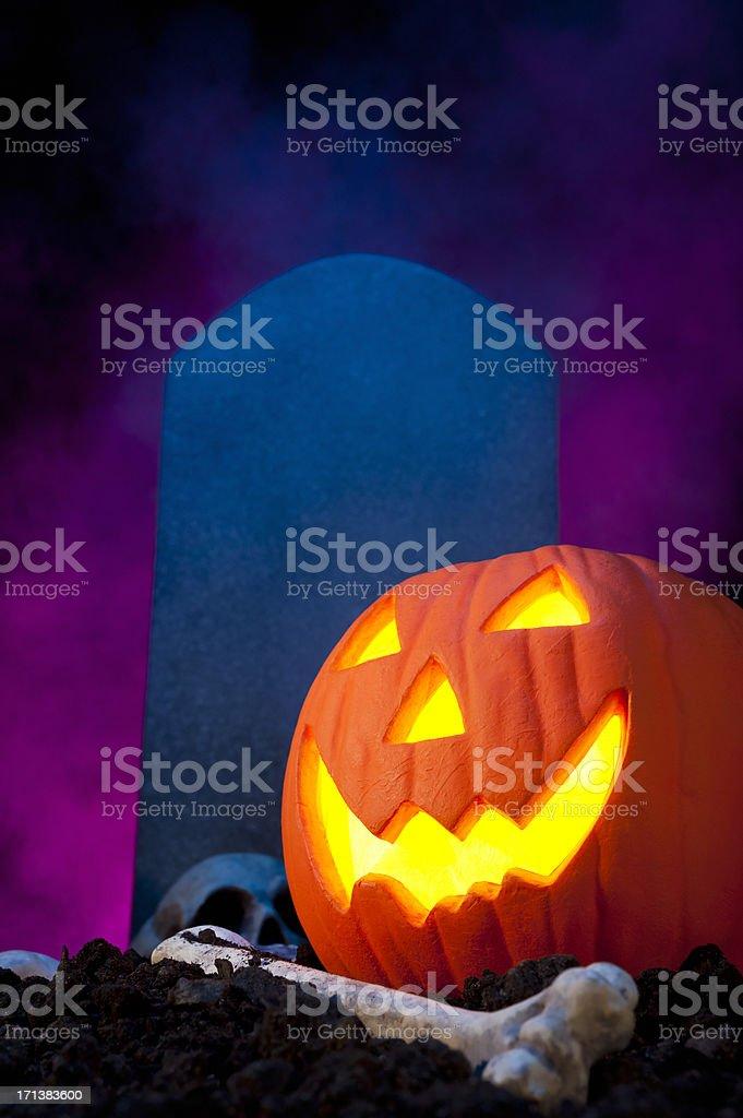 Jack O Lantern, Skull and Tombstone royalty-free stock photo