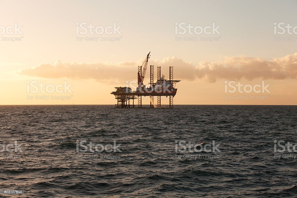 Jack Up heavy lift ship at sunset stock photo