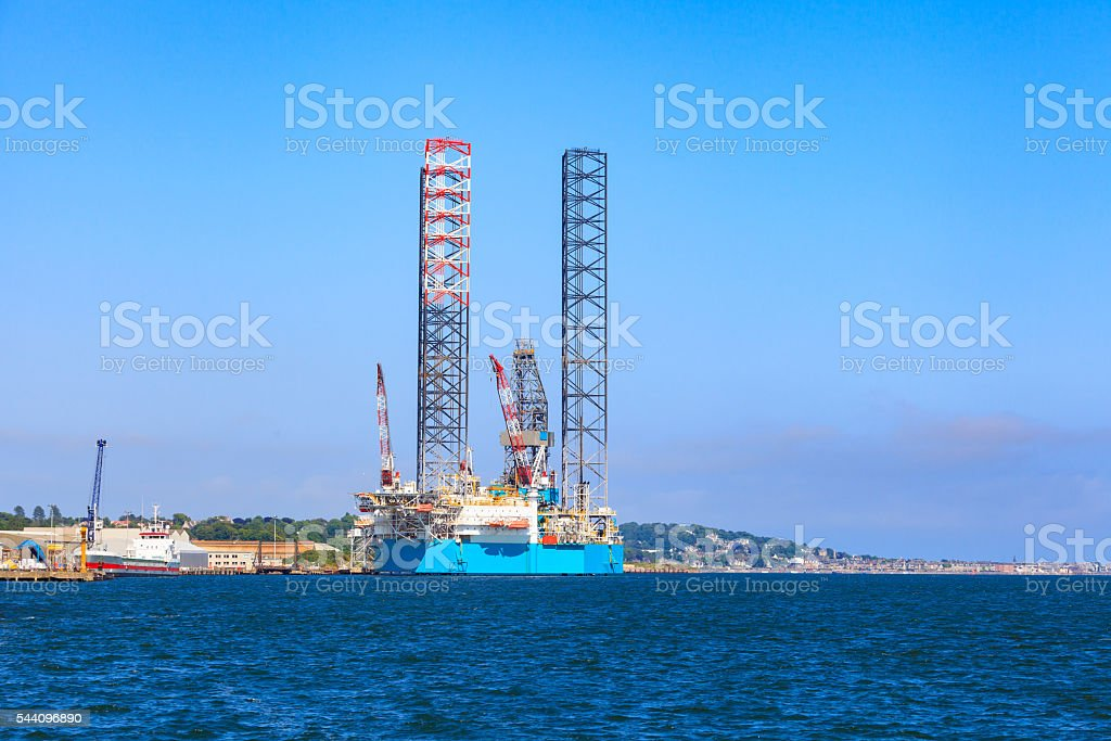 Jack up oil drilling rig in the shipyard for maintenance stock photo
