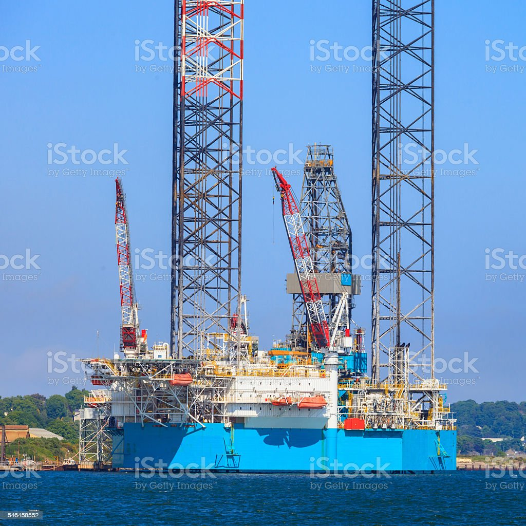 Jack up oil drilling rig in the shipyard stock photo