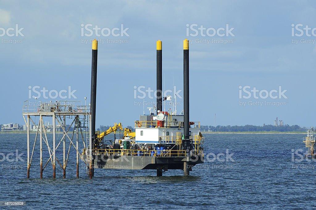 Jack up work boat platform stock photo