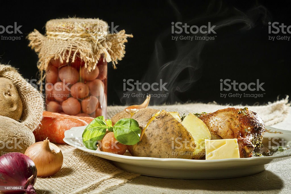 Jacket potatoes and roast chicken serve with vegetables royalty-free stock photo