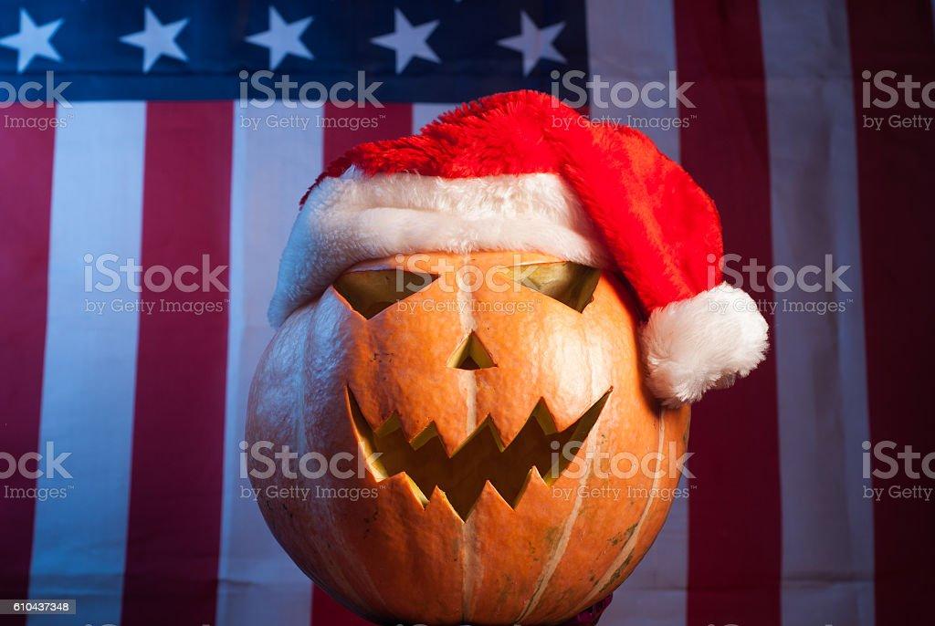 Jack-o '- lantern in a red Santa hat stock photo