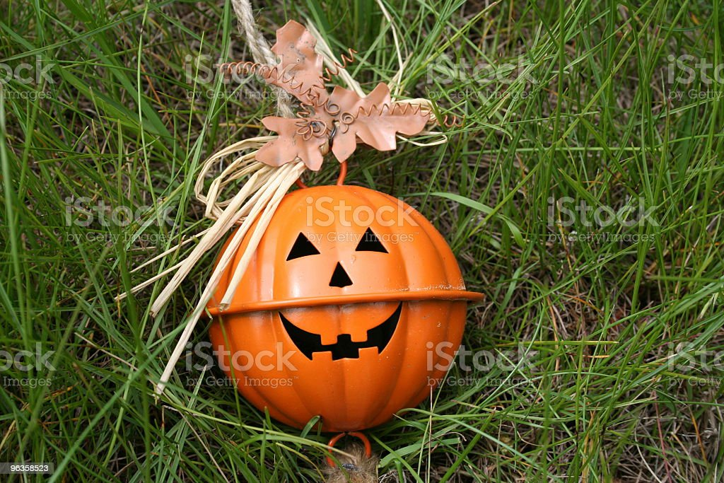 jack-o-lantern ornament in grass stock photo