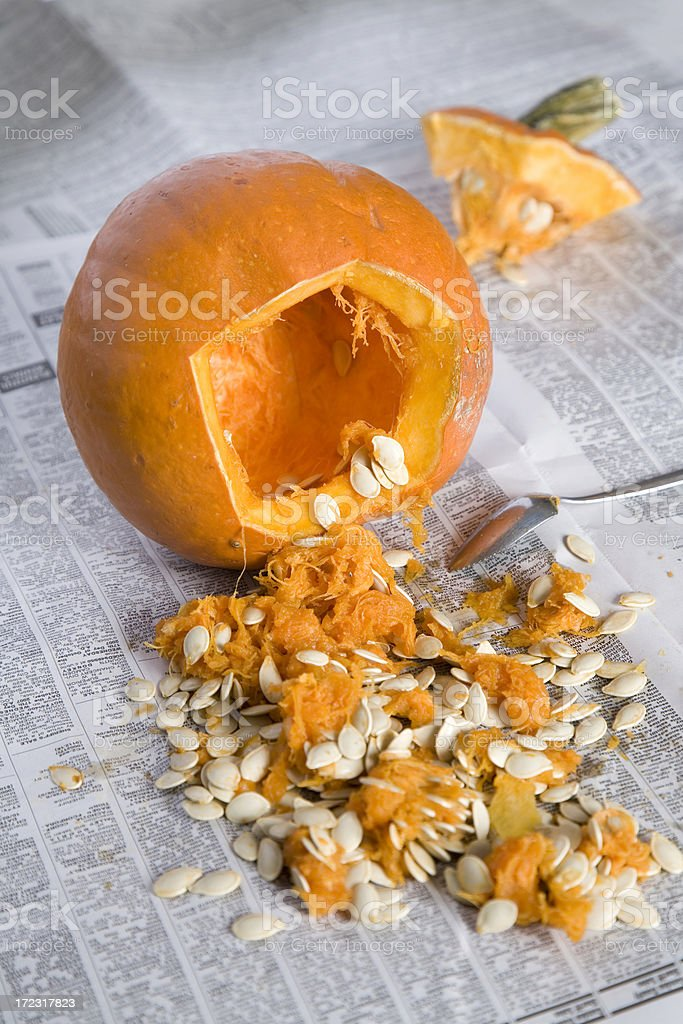 Jack-o-lantern Pumpkin Carving, Seeds and Pulp on Newspaper stock photo
