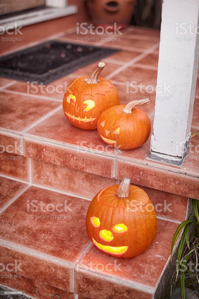 Jack-O'Lanterns on a Front Porch royalty-free stock photo