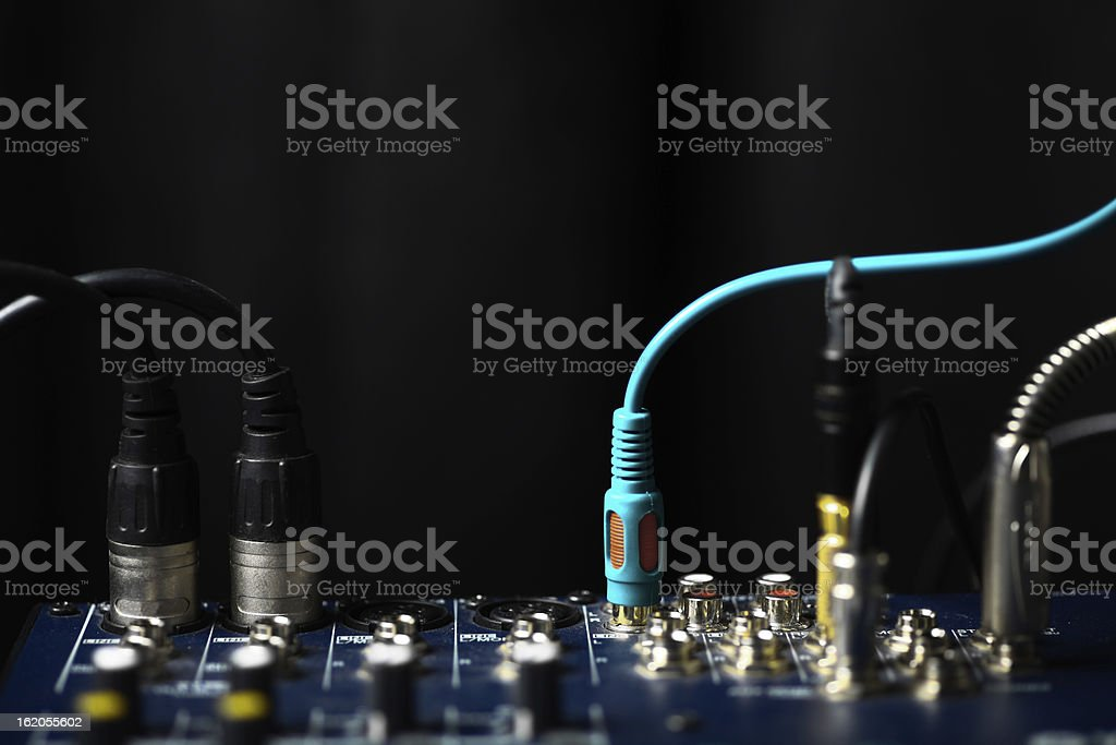 Jacks and leads inserted into a piece of equipment royalty-free stock photo