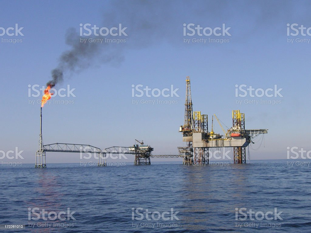 Jackup over a producing platform stock photo