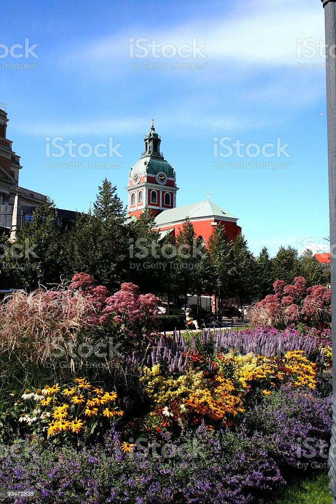 Jacobs church and flowers stock photo