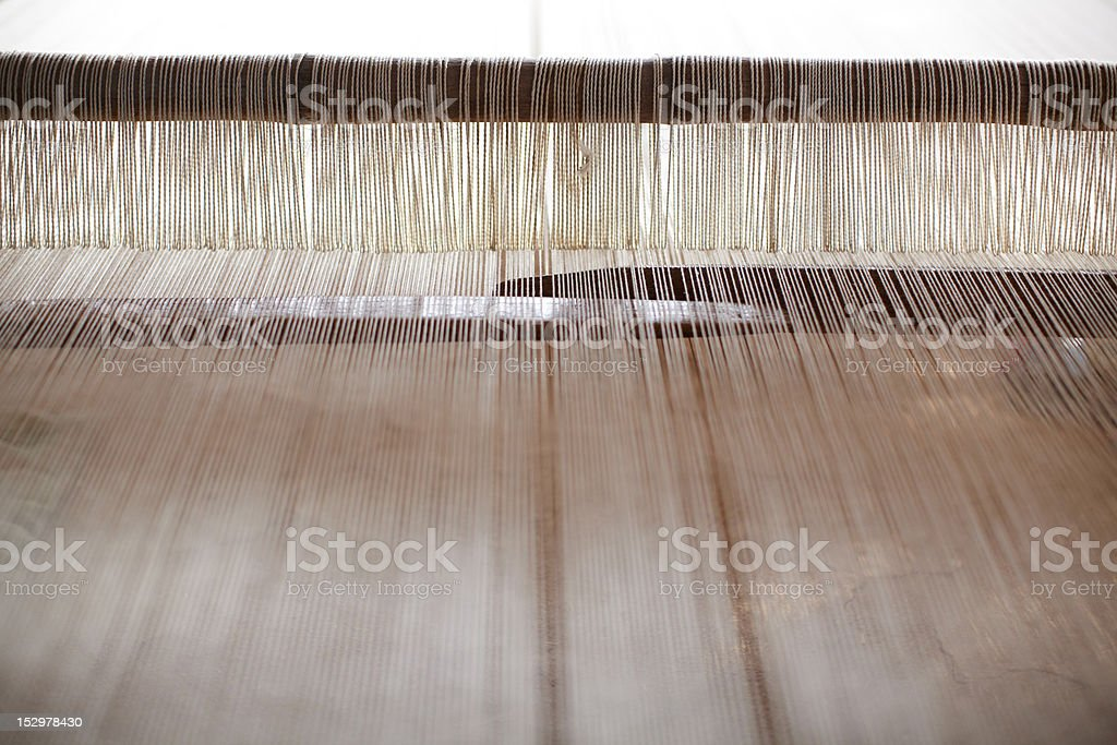 Jacquard loom hand weaving with white wool royalty-free stock photo