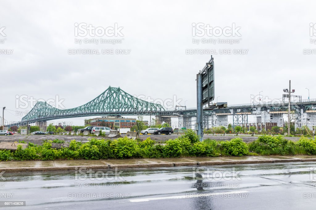 Jacques Cartier bridge during rainy cloudy day in Quebec region city stock photo