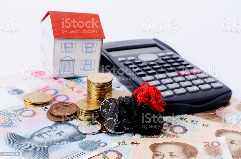 Jade black and coins stack with china banknote and paper house and calculator stock photo