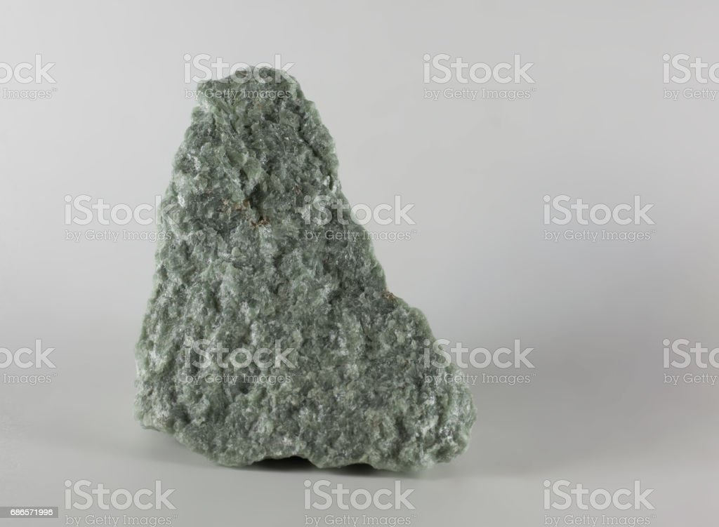 Jade mineral stone, isolated on white background stock photo