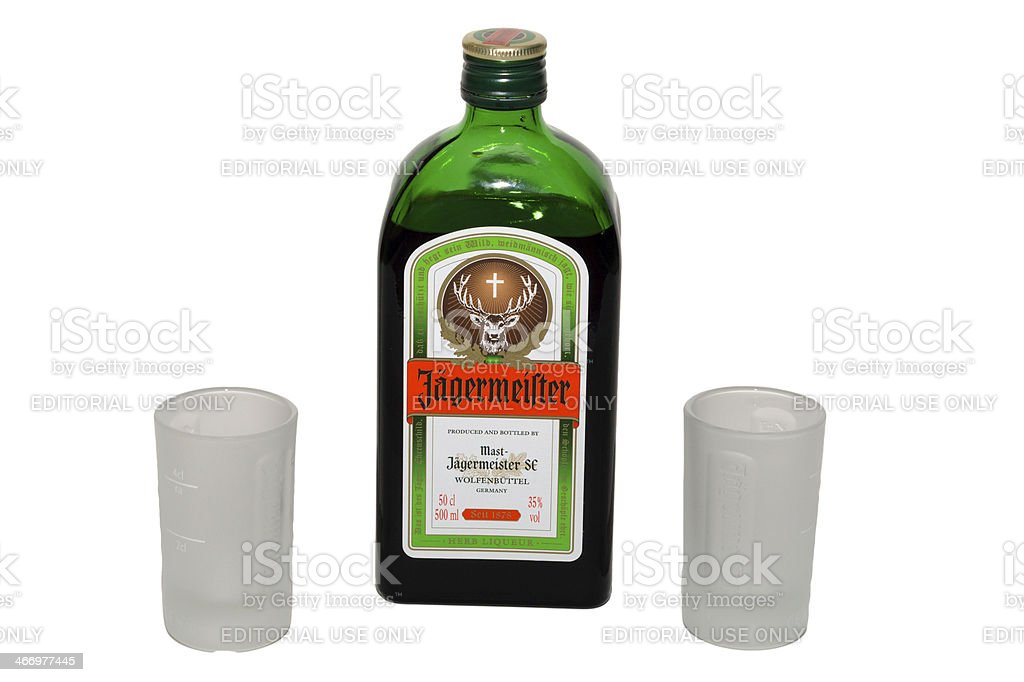 Jagermeister bottle with shot glasses stock photo