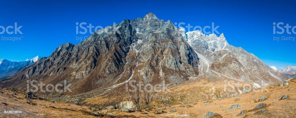 Jagged mountain peaks pinnacles panorama remote Himalaya valley Khumbu Nepal stock photo