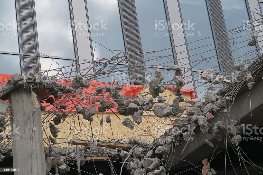 jagged rebar construction old meets new concrete & glass stock photo
