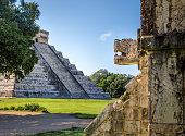 Jaguar head and pyramid  of Kukulkan - Chichen Itza, Mexico