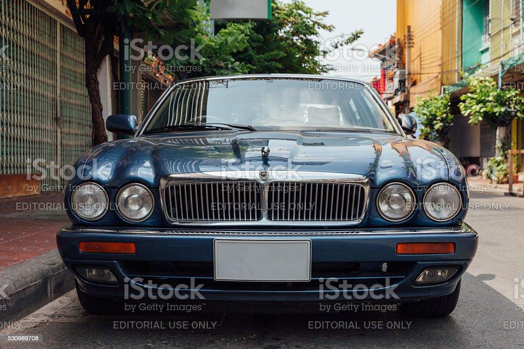 Jaguar Sovereign parked on the street of Bangkok stock photo