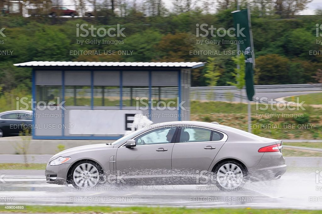 Jaguar XF skidding stock photo