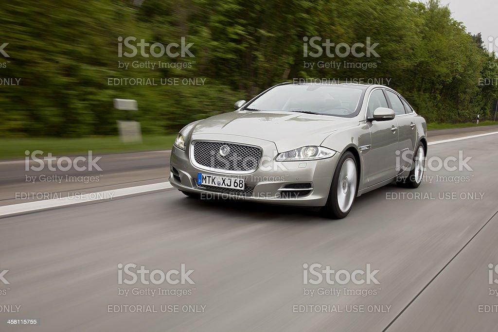 Jaguar XJ driving stock photo