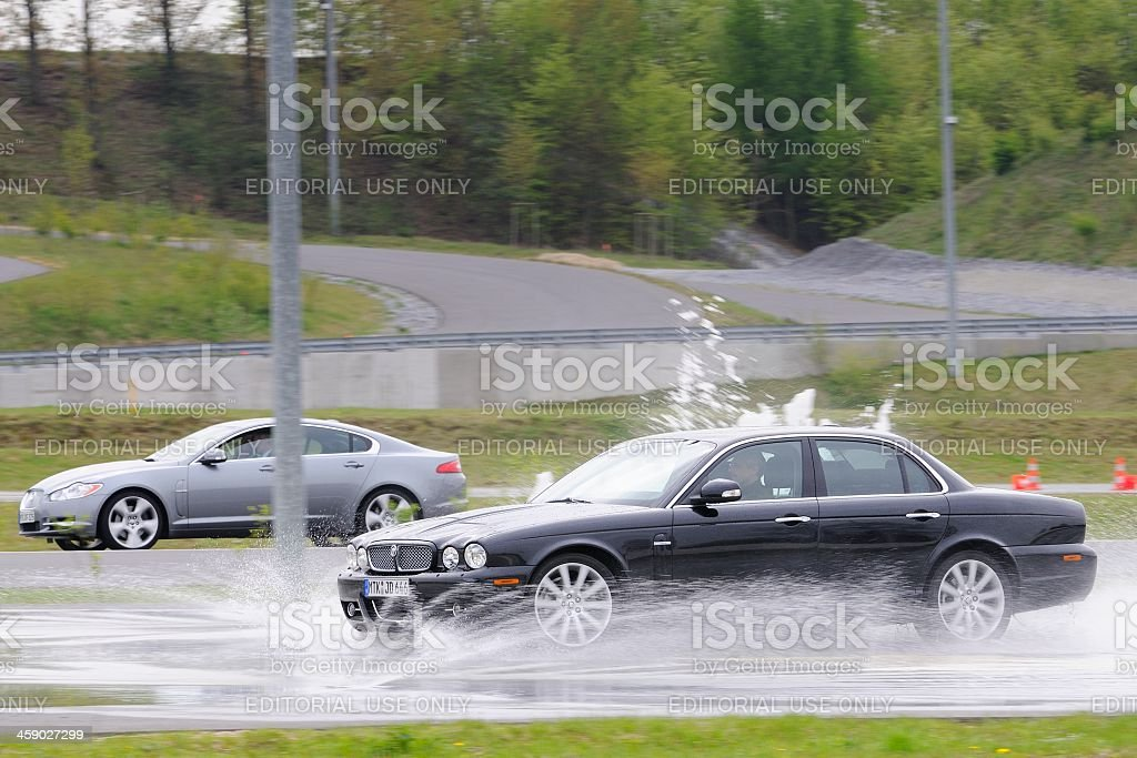 Jaguar XJ skidding stock photo