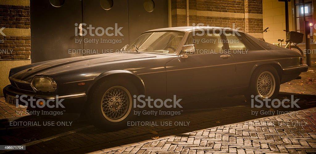 Jaguar XJ-S sports car at night stock photo