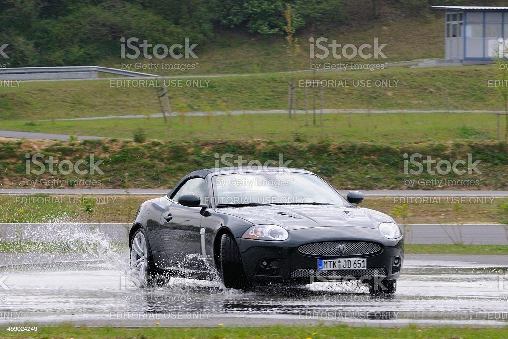 Jaguar XKR skidding royalty-free stock photo