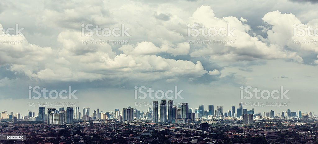 Jakarta city view with Kampung in foreground stock photo