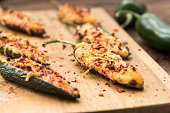 Jalapeno baked with cheese, sauce and flakes of red pepper