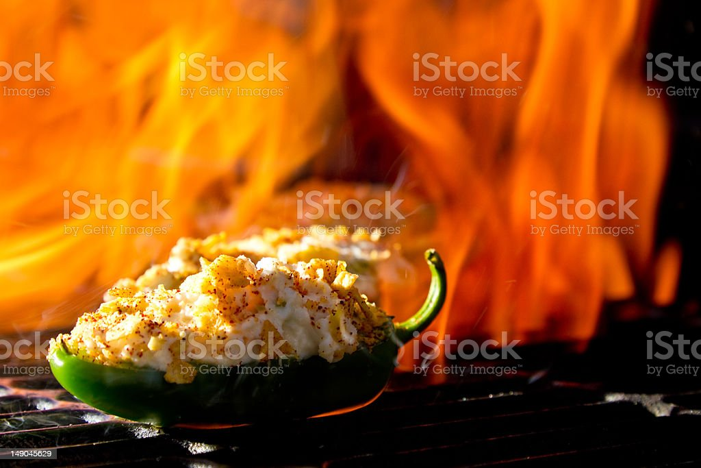 Jalapeno Poppers on Grill with Fire royalty-free stock photo