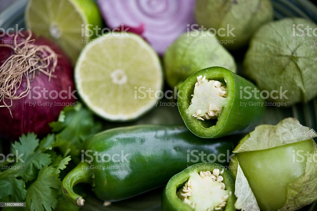jalapenos, tomatillos, onions, limes, and cilantro stock photo