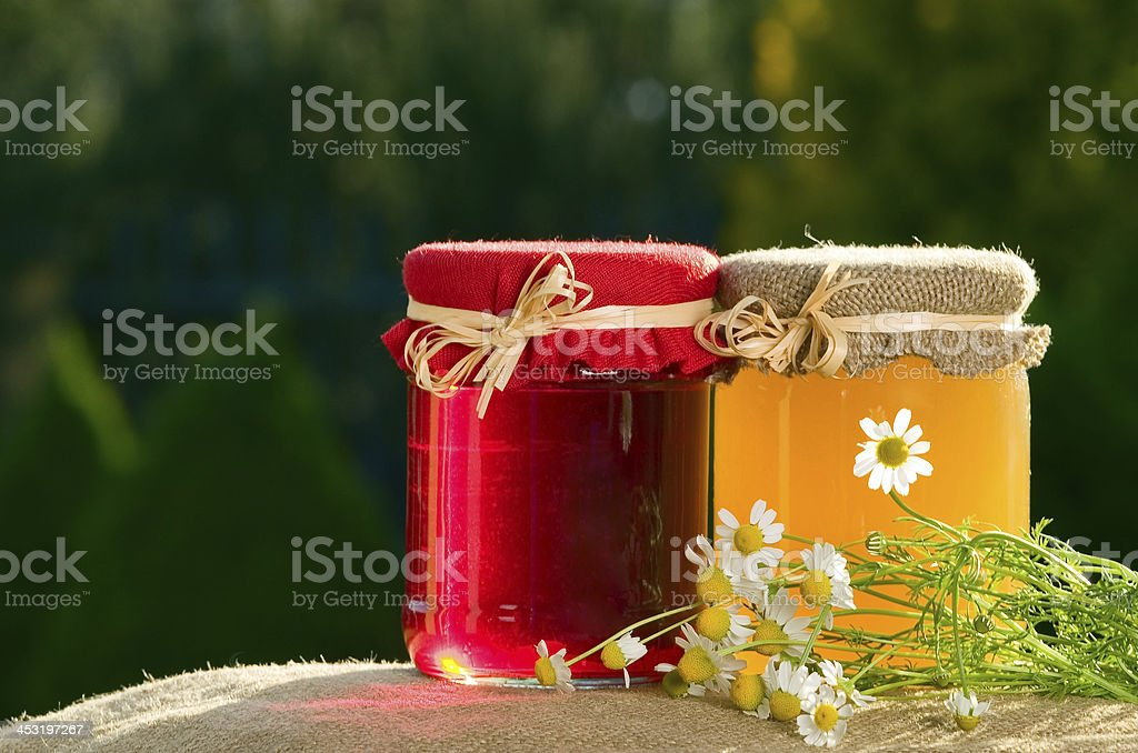 Jam and honey on green background royalty-free stock photo
